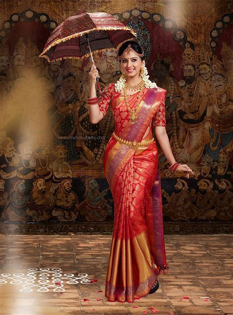 South Indian Bride wearing Silk Saree and Holding the