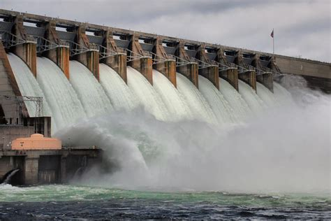 And The Floodgates Been Opened by Hartwell Dam With Flood Gates Open Photograph By Lynne Jenkins