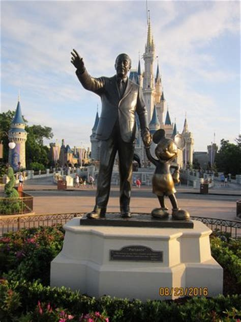 a famous statue of walt disney with mickey mouse in the