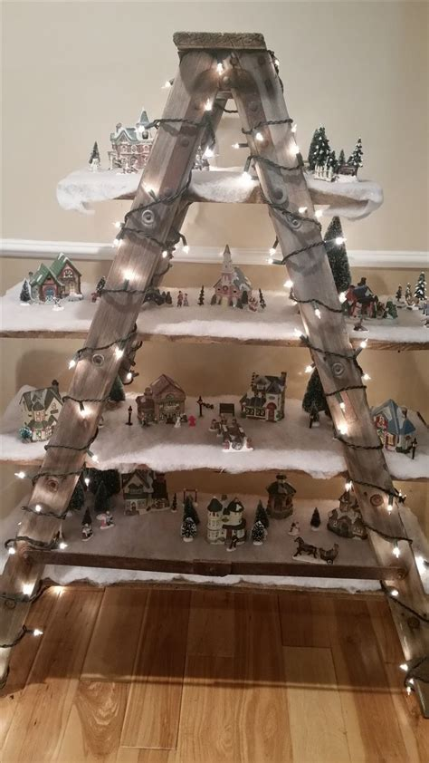 christmas village ladder display this kinda makes me wish we hadn t gotten rid of all jeffs houses and stuff just a