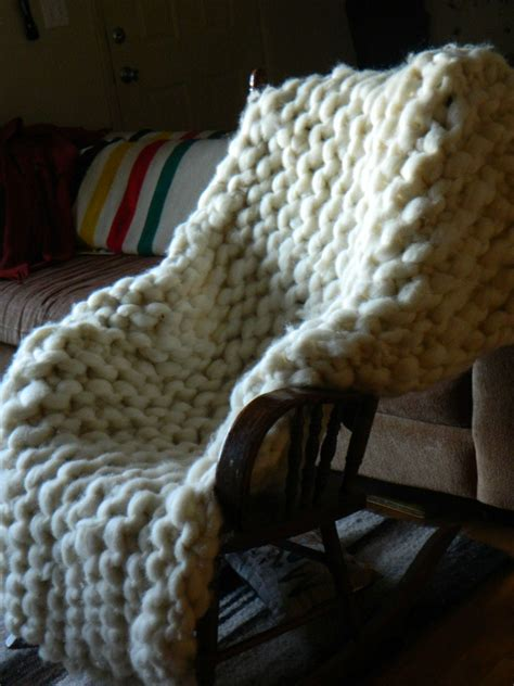 big knitting wool knitter makes a blanket with rope thick wool yarn