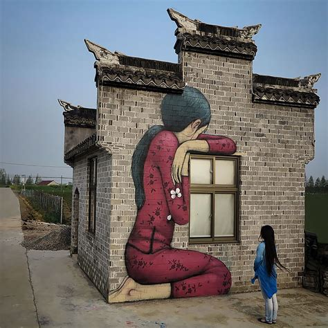 french street artist transforms boring buildings