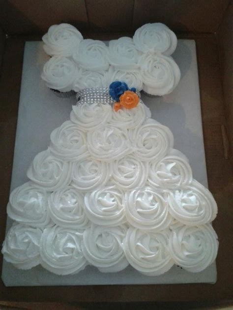 bridal shower cupcakes in shape of wedding dress cupcake cake in the shape of a wedding dress for a bridal shower bling for a belt and roses in