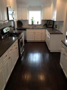 white kitchen cabinets dark wood floors kitchen dark counters dark floors white cabinets
