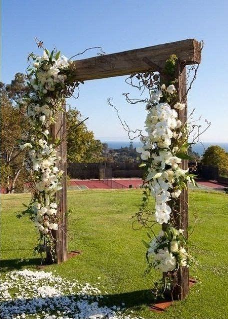 Picture Of rustic wooden wedding arch decorated with white