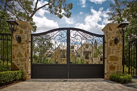 impressive wrought iron gates defining landscaping designs driveway paver patterns with wrought