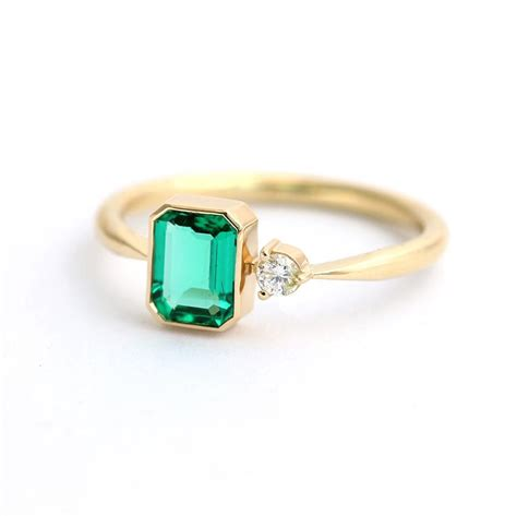 emerald engagement ring with artemer