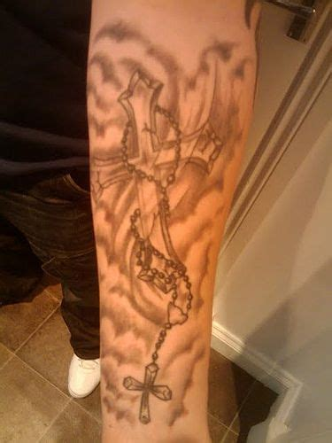 tattoo cross and clouds clouds and rosary cross tattoo tattoos pinterest