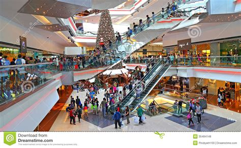 christmas shoppers at shopping mall editorial stock photo