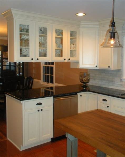 Kitchen Peninsula Cabinets This Kitchen Remodel Features Aristokraft Maple Cabinetry In The Landen Door Style In White
