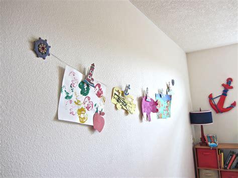 hanging kids artwork diy clothesline art display enchantedyankee