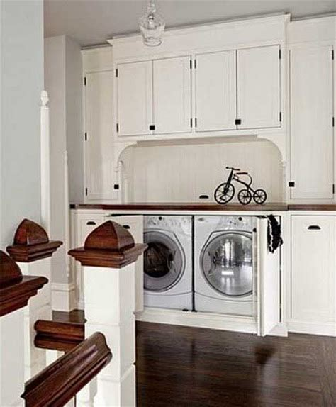 cabinets to hide washer and dryer 25 ideas to hide a laundry room amazing diy interior