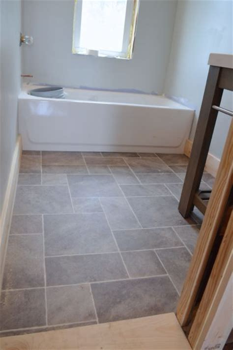 laminate flooring in a bathroom why i love sheet vinyl and other barn apartment updates