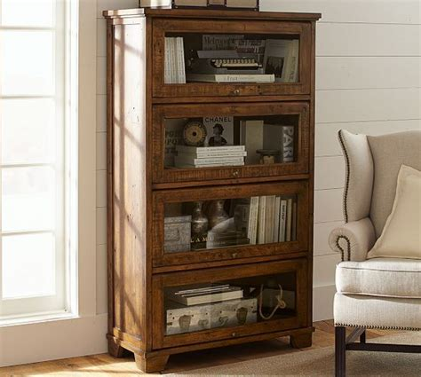 closed bookshelf with glass front lift doors like a