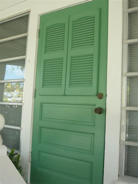 Front Door With Screen Door Front Door Screen Makeover With Shutters The Inspired Room