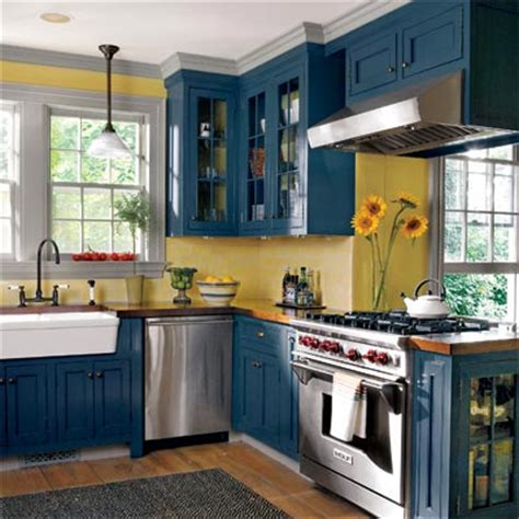 blue and yellow kitchen space smart and storage loaded editors picks our