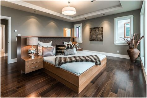 dark wood floors with light gray walls and white trim love the dark bamboo floors and pewter walls living room