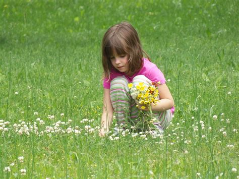 the flower childs play free images nature outdoor blossom person plant field lawn meadow play flower