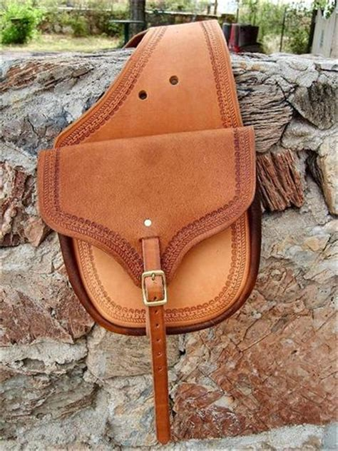 Handmade Saddlebags - the plainsman leather saddlebags with border tooling