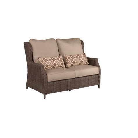 brown vineyard patio loveseat with sparrow cushions