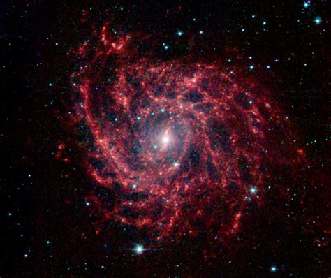 galaxy cosmic spiral galaxy glows like a cosmic spider web nasa s