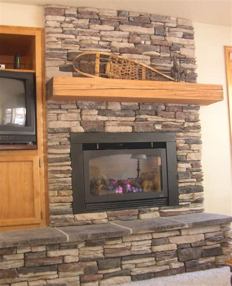 stone fireplace wall faux stacked stone paint treatment racks and wooden