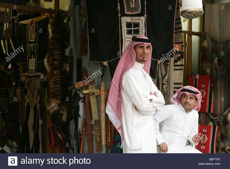 men long hair doha qatar men in traditional attire at the souq waqif market in doha
