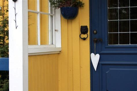 yellow house with blue door love the blue door with yellow house beautiful front