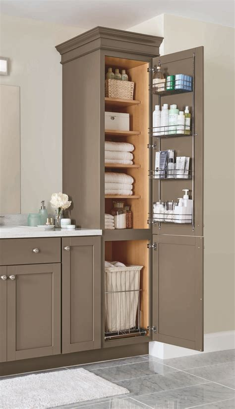 Bathroom Linen Shelves A Linen Closet With Four Adjustable Shelves A Chrome Door Rack And A Pull Out Her Helps