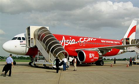 airasia agent asian low cost airline takes millions to the sky