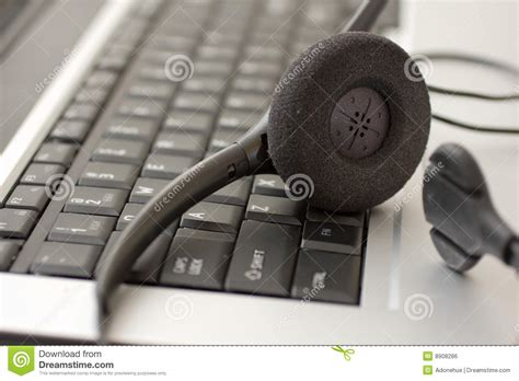 phone operator work from home headset next to laptop royalty free stock image image
