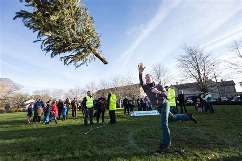 public lumbers up for christmas tree throwing contest
