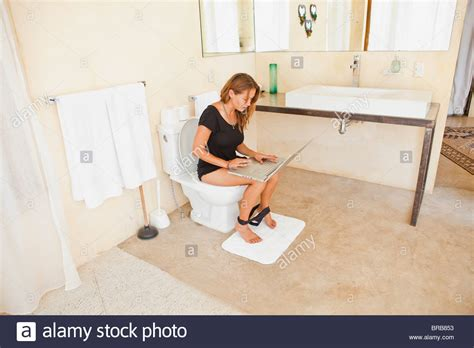 brb bathroom woman on laptop in bathroom stock photo royalty free image 31595343 alamy