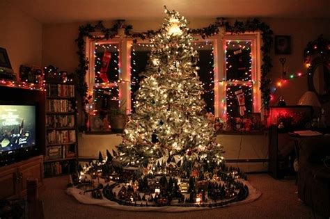 a train around the christmas tree christmas pinterest