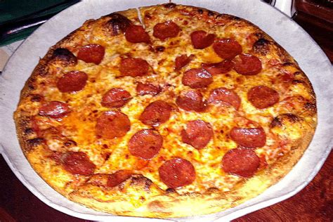 pizza with in crust photo thin crust pizza from darcy s pub quincy