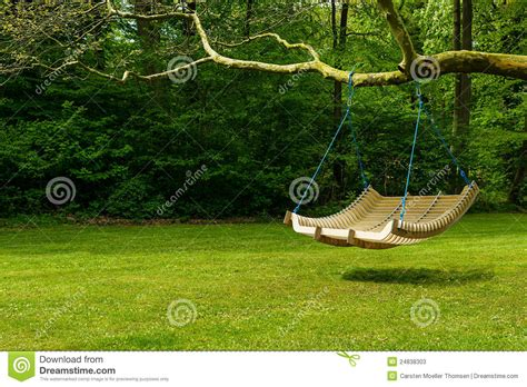 swing in the garden swing bench in lush garden stock image image of informal