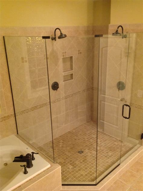 Custom Frameless Shower Doors A Shower Enclosure Installed In A Forest Area Home Features Rubbed Bronze