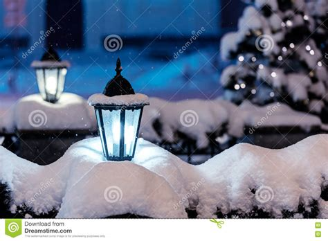 snowy street ls in night city with fir tree and