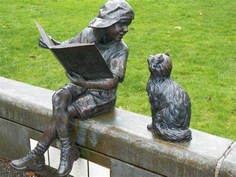 reading statue  boy   cat book sculpture