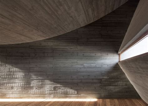 Concave Ceiling by Vector Architects Completes A Concrete Seaside Library A