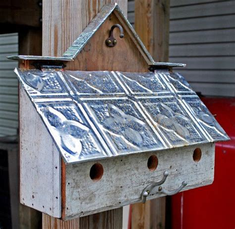 3 unit barn style bird house with reclaimed materials on