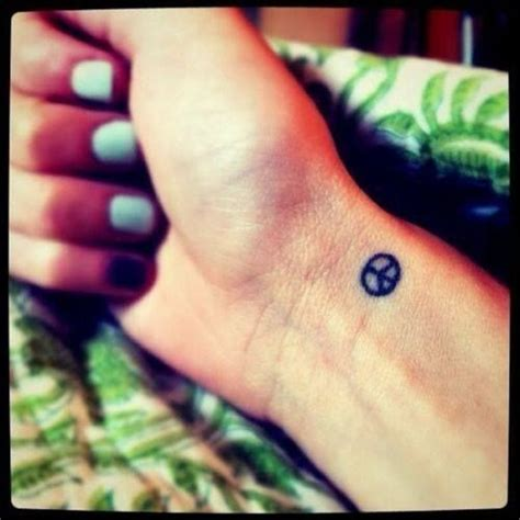 36 classic peace symbol wrist tattoos design