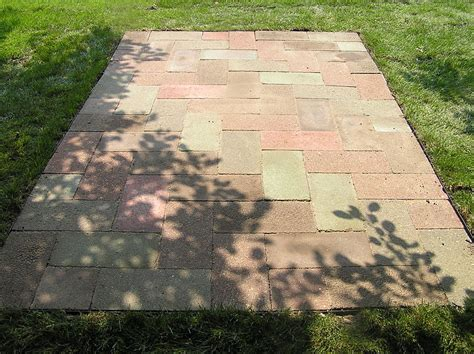 build a paver patio sand base