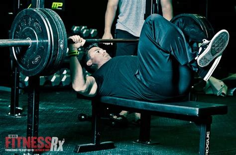 feet up bench press lift your feet boost your bench fitnessrx for men