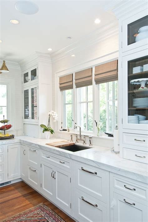 kitchen cabinets with windows 3 kitchen window treatment types and 23 ideas shelterness