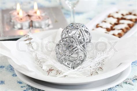 Candle Decoration At Home christmas table setting in white and silver tone stock