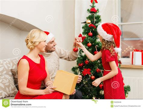smiling family decorating christmas tree royalty free
