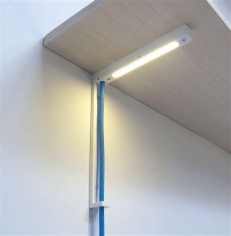 cool shelf task light integrated into shelf bracket