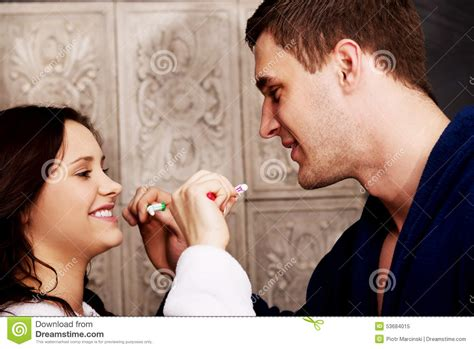 couples in bathroom couple in the bathroom brushing teeth stock photo image