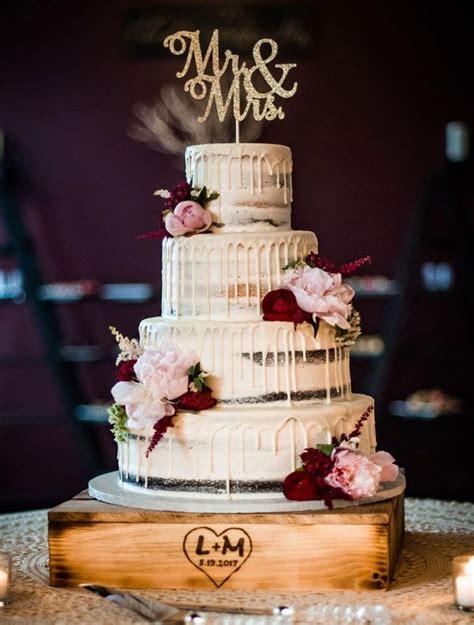 tier semi naked wedding cake decorated  burgundy